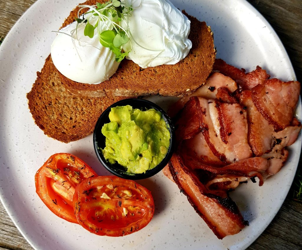 Eggs on toast with avo and bacon